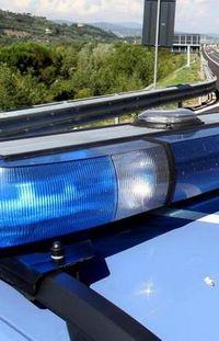 Polizia stradale controlla il tratto Fiorentino dell' autostrada del Sole A1, in concomitanza del primo fine settimana di vacanze estive, Firenze, 1 agosto 2014. ANSA/CLAUDIO GIOVANNINI